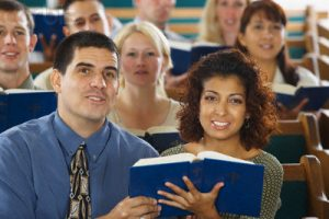 Church Congregation Singing and Holding Hymnals
